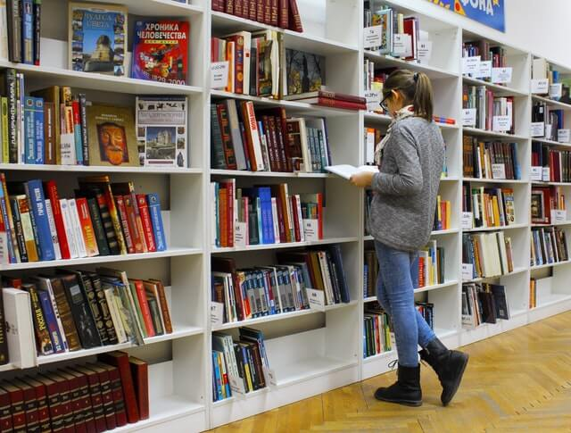 girl looking at books